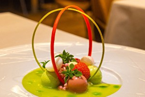 green dish on plate